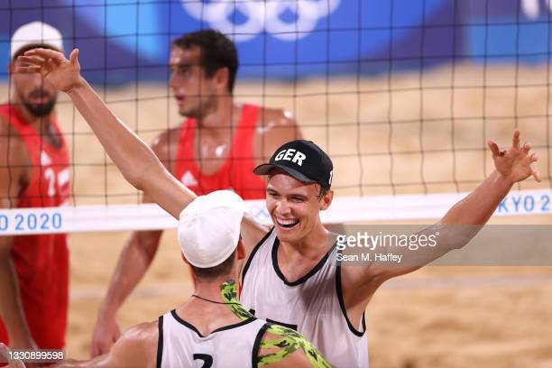 Julius Thole and Clemens Wickler of Team Germany react after defeating Team Poland during the Men's Preliminary - Pool F beach volleyball on day four...