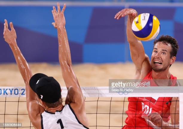 Julius Thole of Team Germany competes with Piotr Kantor of Team Poland during the Men's Preliminary - Pool F beach volleyball on day four of the...