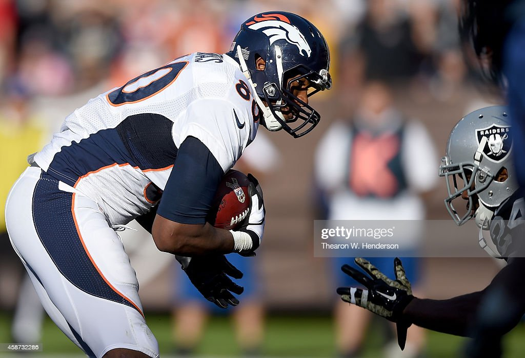 Julius Thomas #80 of the Denver Broncos lowers his shoulders towards the endzone on a 10 yard touchdown pass play against the Oakland Raiders during the third quarter at O.co Coliseum on November 9, 2014 in Oakland, California.