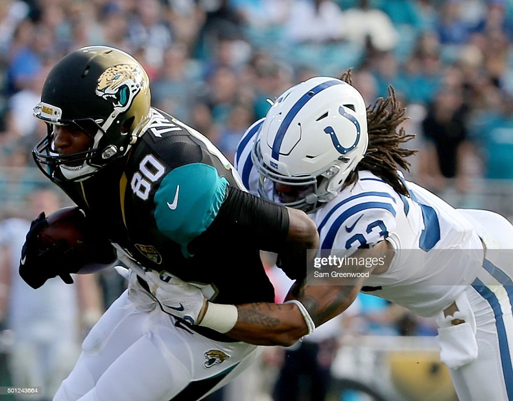 Julius Thomas #80 of the Jacksonville Jaguars rushes against Dwight Lowery #33 of the Indianapolis Colts during the game at EverBank Field on December 13, 2015 in Jacksonville, Florida.