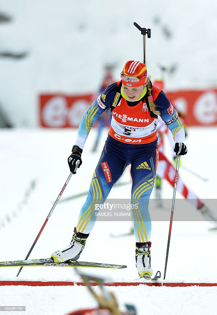 Juliya Dzhyma of Ukraine crosses the finish line of the women's10km pursuit competition of the IBU Biathlon World Cup in Hochfilzen, Austria, on December 8,2013. Norway's Synnoeve won ahead of Ukraine's Julia Dzyhma and Poland's Krystyna Palka.