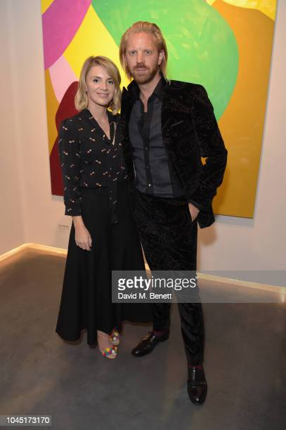 Julliette Loughran and Alistair Guy attend the 21st Century Women VIP preview at Unit London Mayfair London on October 3 2018 in London England