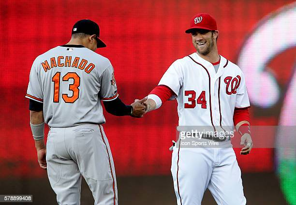Washington Nationals left fielder Bryce Harper greets Baltimore Orioles third base Manny Machado before a MLB game at Nationals Park in Washington DC