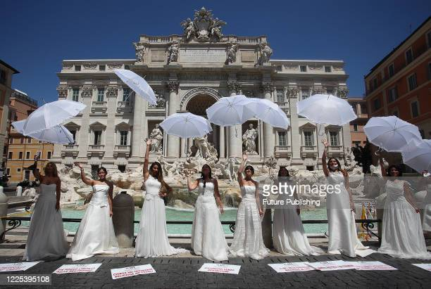 JULY 07,2020: Brides wearing their wedding gown hold a flashmob protest against the postponement of their marriages due to the rigorous protocol of...
