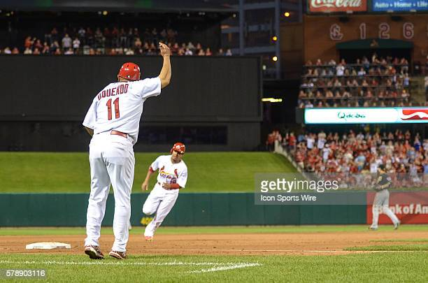 St Louis Cardinals Third Base Coach Jose Oquendo waves St Louis Cardinals Outfielder Jon Jay [6757] on toward home in the fifth inning after Left...