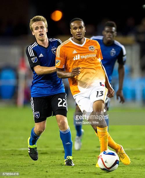 Houston Dynamo midfielder Ricardo Clark passes as San Jose Earthquakes midfielder Tommy Thompson chases him during a Major League Soccer match...