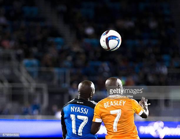 San Jose Earthquakes midfielder Sanna Nyassi and Houston Dynamo defender/midfielder DaMarcus Beasley battle for aerial possession during a Major...