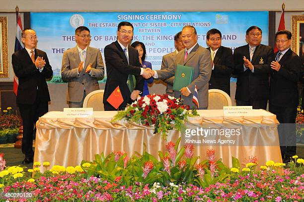 July 10, 2015-- Bangkok governor Sukhumphan Boriphat, right front, shakes hands with vice mayor of Shenzhen Municipal Government of China Ai Xuefeng,...