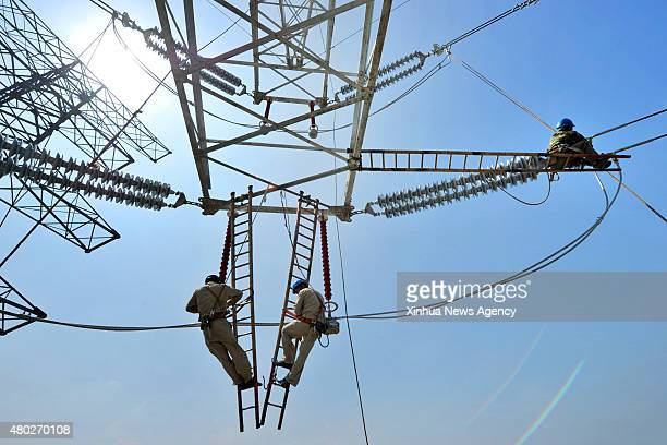 WUXI July 10 2015 Staff members of local power department check the power grid in Jiangyin east China's Jiangsu Province July 10 2015 China is on...