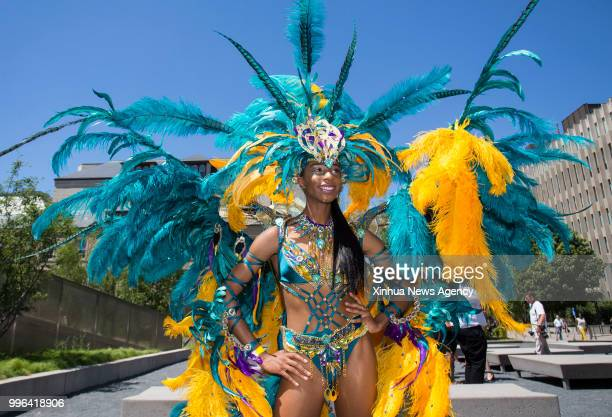 A reveller poses for photos during the official launch ceremony of the 2018 Toronto Caribbean Carnival at Nathan Philips Square in Toronto Canada...