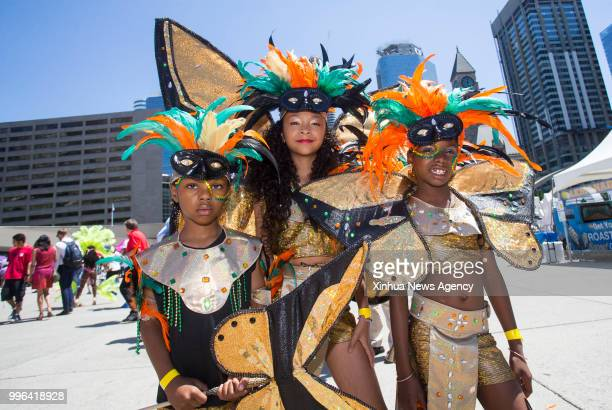 Little revellers pose for photos during the official launch ceremony of the 2018 Toronto Caribbean Carnival at Nathan Philips Square in Toronto...