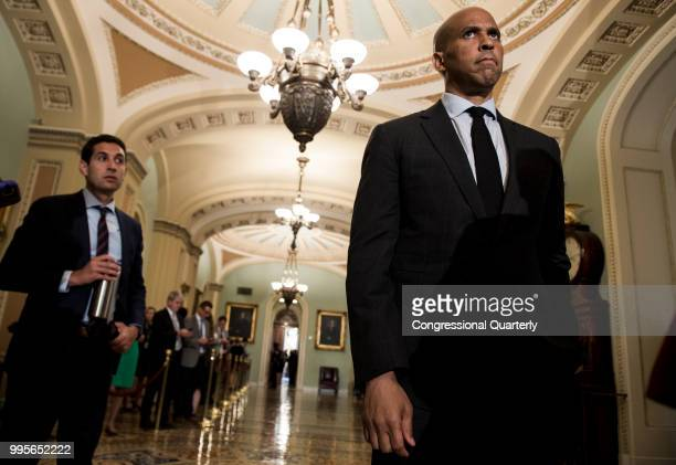 Senate Cory Booker DNJ listens as Senate Minority Leader Charles Schumer DNY speaks to the press after the Senate Democrats' policy lunch in the...