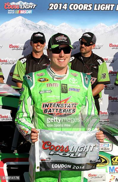 Kyle Busch celebrates winning the pole for the Sprint Cup Series Camping World RV Sales 301 at New Hampshire Motor Speedway in Loudon, NH.