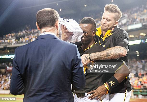 Pittsburgh Pirates starting pitcher AJ Burnett hits center fielder Andrew McCutchen with a whipped cream pie after he hit a walkoff two run home...