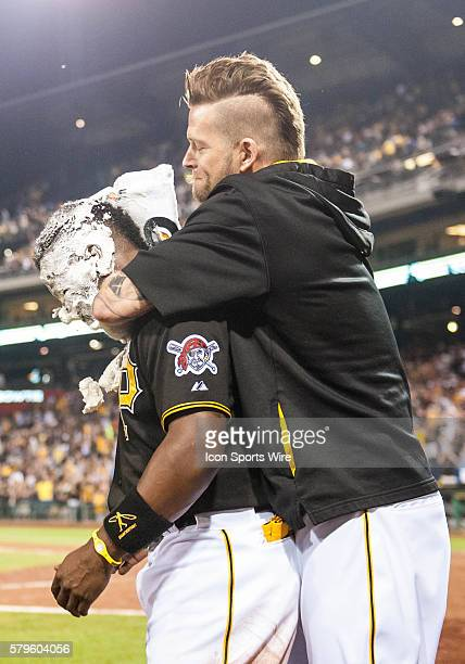 Pittsburgh Pirates starting pitcher AJ Burnett hits Pittsburgh Pirates center fielder Andrew McCutchen with a whipped cream pie after he hit a...