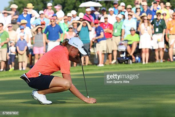 Stacy Lewis sets her ball into place on the 18th green during the third round of the US Women's Open at Lancaster Country Club in Lancaster PA