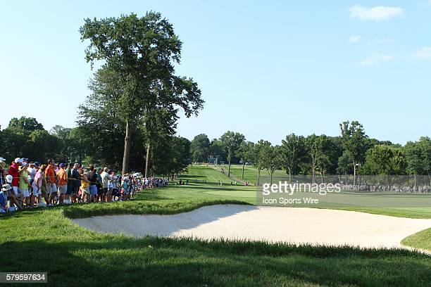 The fans line the 18th fairway as Stacy Lewis and tournament leader Amy Yang get ready to play the final hole of the day during the third round of...