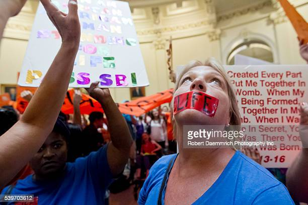 Crowds for and against new law relating to abortions restrictions in Texas voice their opinions as hundreds gather at the Texas Capitol building as...