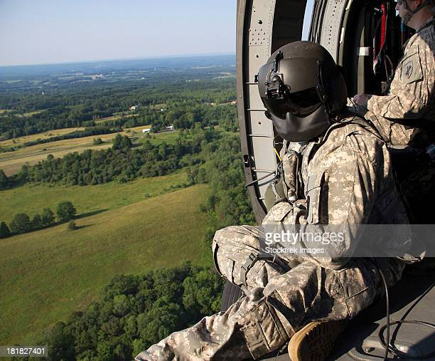 July 12, 2012 - An Army crew chief looks out the door of a UH-60 Black Hawk helicopter during medical evacuation training in Marcy, New York.