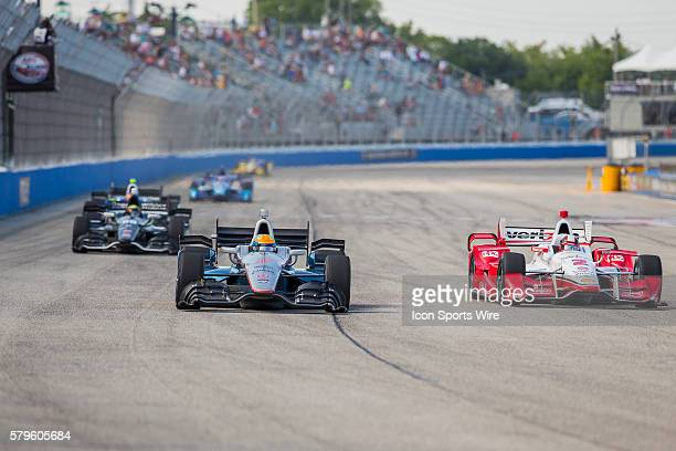 Indy Car Driver Juan Pablo Montoya looks to pass Indy Car Driver James Jakes during the ABC Supply Wisconsin 250 at The Milwaukee Mile in West Allis,...