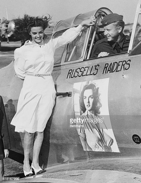July 13 1941 Stockton California Motion picture beauty Jane Russell inspects her own insignia on the training plane of Don Brown son of gapmouthed...