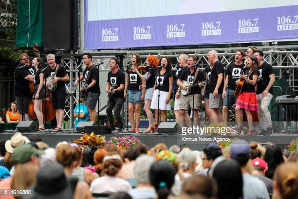 NEW YORK July 13 2017 Members of the Soulpepper Theatre Company perform during Broadway in Bryant Park 2017 show at Bryant Park in New York the...