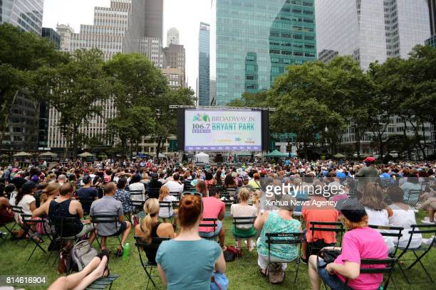 NEW YORK July 13 2017 People watch the performance during Broadway in Bryant Park 2017 show at Bryant Park in New York the United States on July 13...