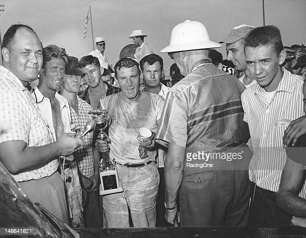 Marvin Panch holds his trophy in victory lane after winning the NASCAR Cup race at MemphisArkansas Speedway Panch drove a Pontiac owned by Herb...
