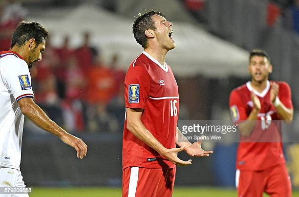 Canada midfielder Maxim Tissot reacts after a missing a shot on the Costa Rica goal during the first half of a Gold Cup match at BMO Field, Toronto,...