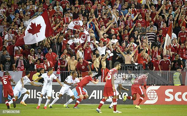 Canadian fans cheer on their team during a corner kick in the second half of a Gold Cup match at BMO Field Toronto ON