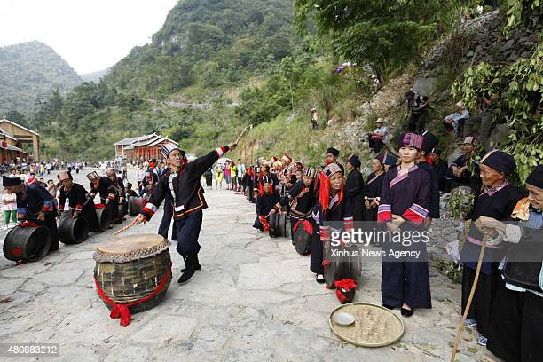 July 14, 2015-- Villagers of the Yao ethnic group dance to welcome guests during the Danu Festival in the Yao ethnic town of Sannong, in Donglan...