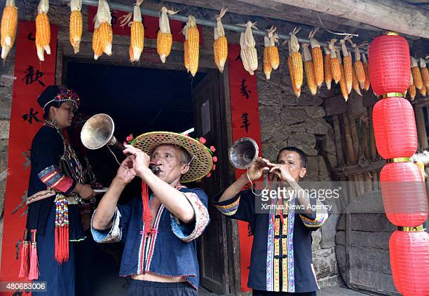July 14, 2015-- Villagers of the Yao ethnic group play suona horn to celebrate the Danu Festival in the Yao ethnic town of Sannong, in Donglan...