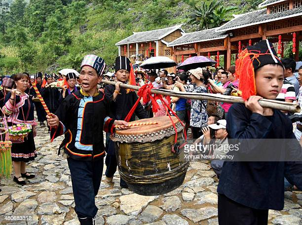 July 14, 2015-- Villagers of the Yao ethnic group sing folk songs to celebrate the Danu Festival in the Yao ethnic town of Sannong, in Donglan...