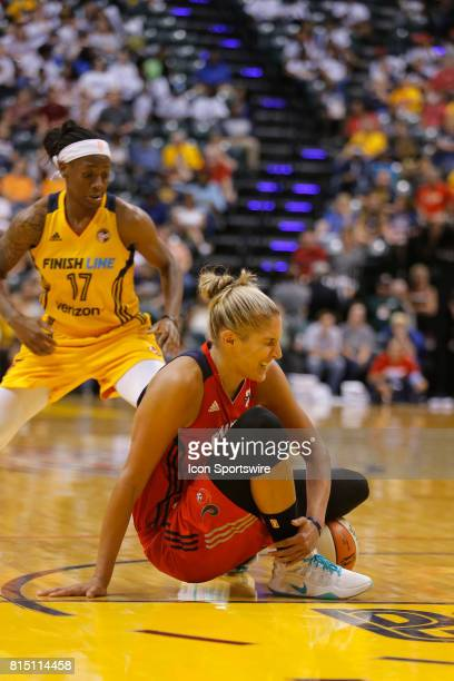 Washington Mystics forward Elena Delle Donne grimaces in pain as she goes down with an injury during the game between the Washington Mystics and...