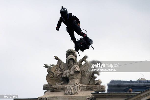 """July 14, 2019 -- Franky Zapata, a French inventor and entrepreneur, flies a jet-powered hover board or """"Flyboard"""" during the annual Bastille Day..."""