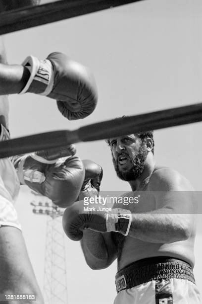 Lyle Alzado , advances toward Muhammad Ali who is against the ropes during an eight-round exhibition match at Mile High Stadium on July 14, 1979 in...