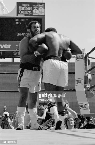 Lyle Alzado and Muhammad Ali lock up in a clinch during an eight-round exhibition match at Mile High Stadium on July 14, 1979 in Denver, Colorado....
