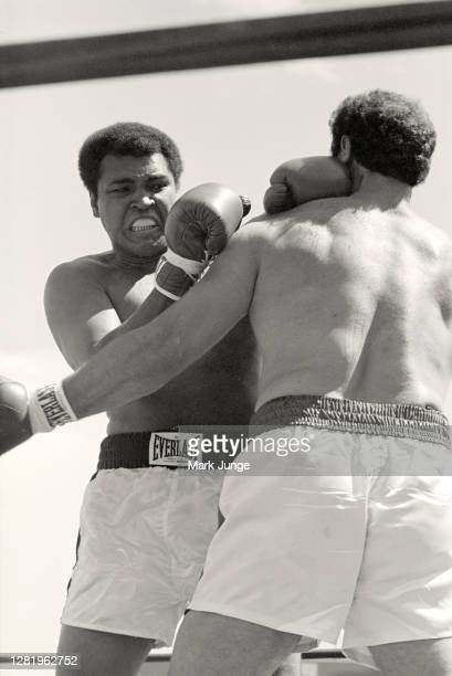 Lyle Alzado , attempts to lock up Muhammad Ali during an eight-round exhibition match at Mile High Stadium on July 14, 1979 in Denver, Colorado....
