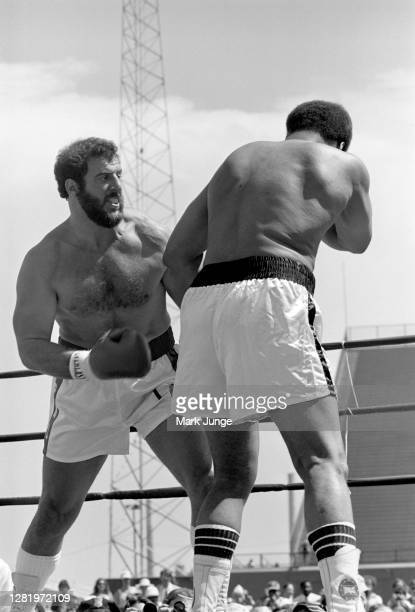 Lyle Alzado ,attempts to throw a right uppercut against Muhammad Ali during an eight-round exhibition match at Mile High Stadium on July 14, 1979 in...