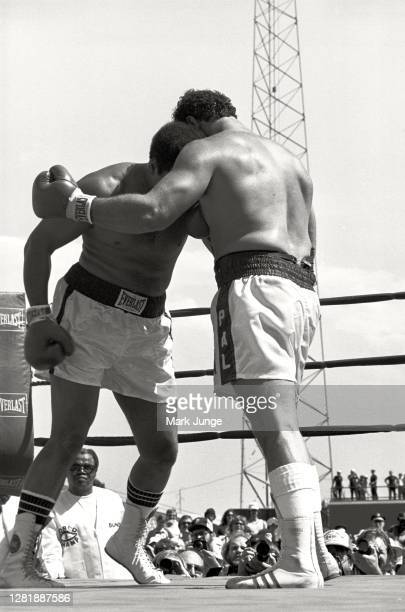 Lyle Alzado , goes into a clinch against Muhammad Ali during an eight-round exhibition match at Mile High Stadium on July 14, 1979 in Denver,...