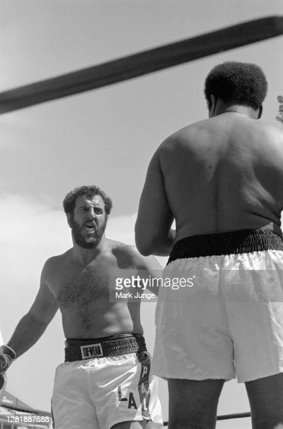 Lyle Alzado , squares off against Muhammad Ali during an eight-round exhibition match at Mile High Stadium on July 14, 1979 in Denver, Colorado....