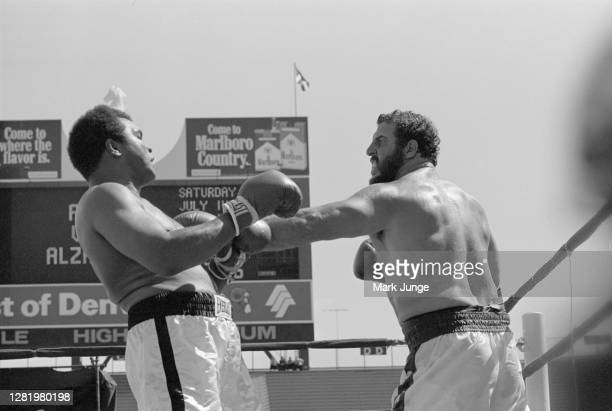 Muhammad Ali , blocks a jab from Lyle Alzado during an eight-round exhibition match at Mile High Stadium on July 14, 1979 in Denver, Colorado. Ali...