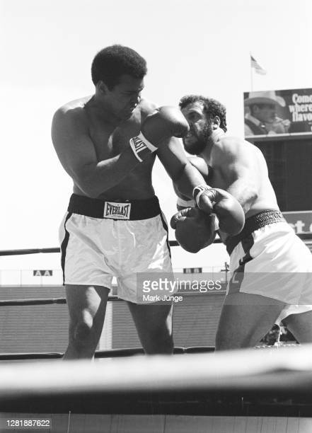 Muhammad Ali , blocks a left hook from Lyle Alzado during an eight-round exhibition match at Mile High Stadium on July 14, 1979 in Denver, Colorado....