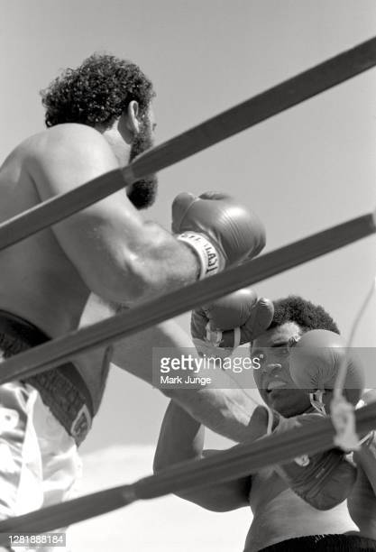 Muhammad Ali , blocks a left jab from Lyle Alzado during an eight-round exhibition match at Mile High Stadium on July 14, 1979 in Denver, Colorado....