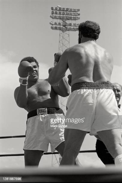 Muhammad Ali , blocks a punch from Lyle Alzado during an eight-round exhibition match at Mile High Stadium on July 14, 1979 in Denver, Colorado. Ali...