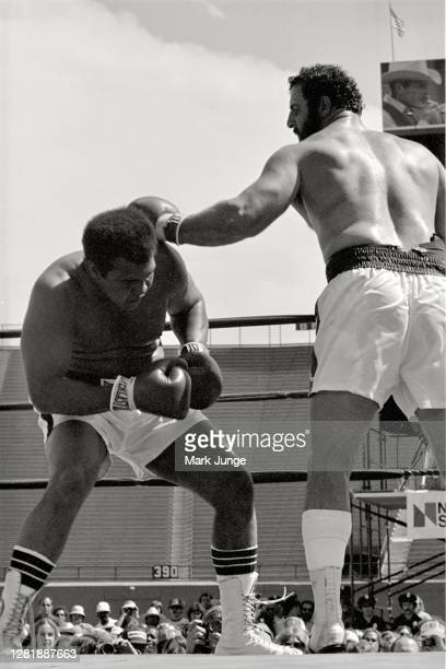 Muhammad Ali , ducks under a left jab from Lyle Alzado during an eight-round exhibition match at Mile High Stadium on July 14, 1979 in Denver,...