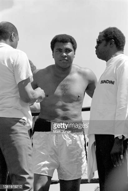 Muhammad Ali stands in his corner flanked by his assistants during an eight-round exhibition match with Lyle Alzado at Mile High Stadium on July 14,...