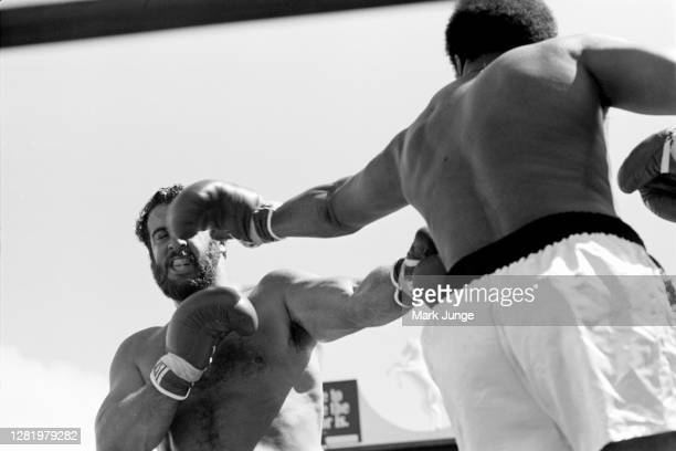 Muhammad Ali , throws a left jab against Lyle Alzado during an eight-round exhibition match at Mile High Stadium on July 14, 1979 in Denver,...