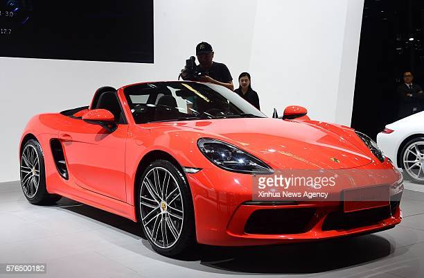 CHANGCHUN July 15 2016 A videographer records a Porsche car at the 13th China Changchun International Automobile Expo held in Changchun northeast...