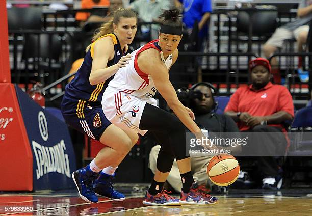 Natasha Cloud of the Washington Mystics shields the ball from Jeanette Pohlen of the Indiana Fever during a WNBA game at Verizon Center in Washington...